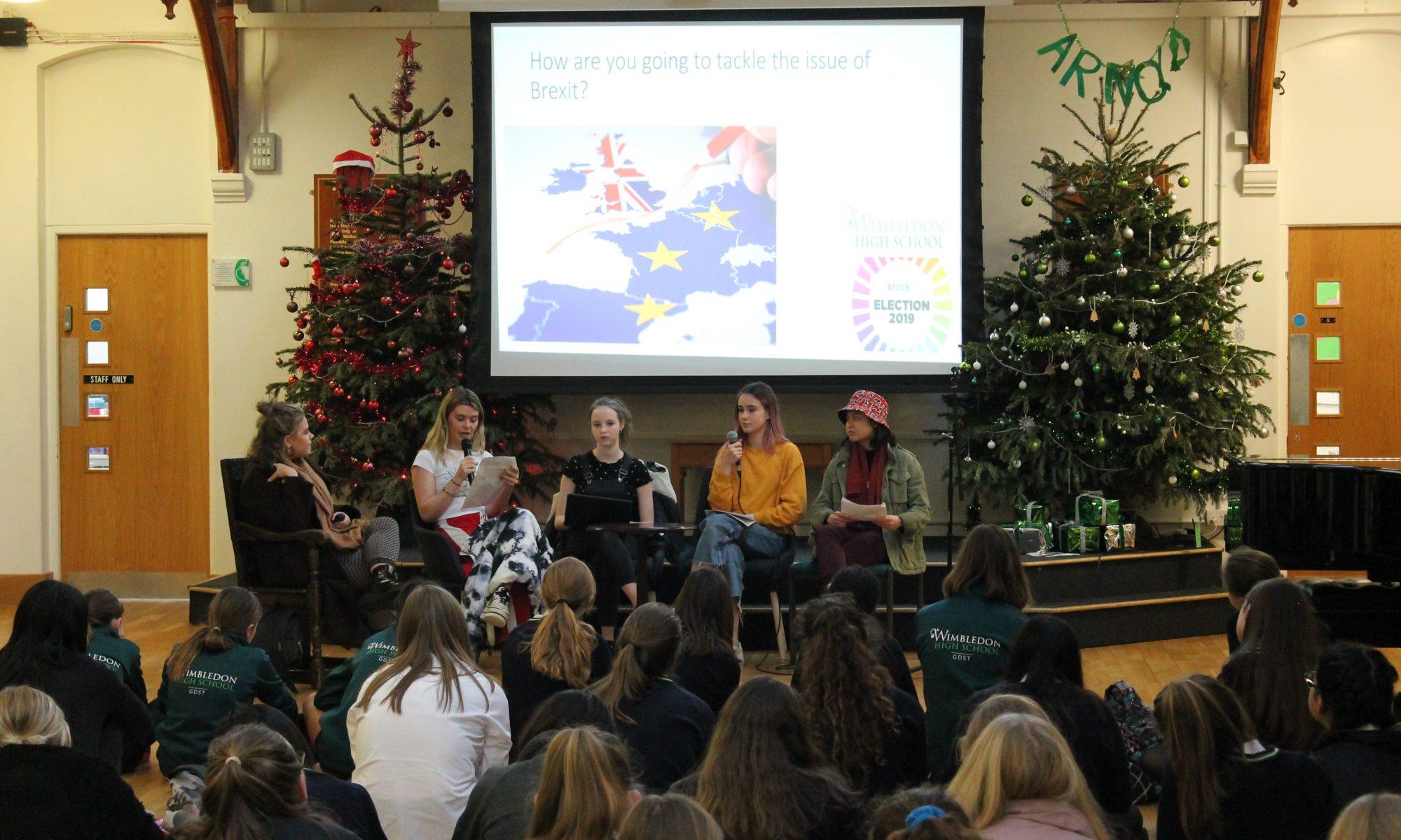 Students debating at WHS